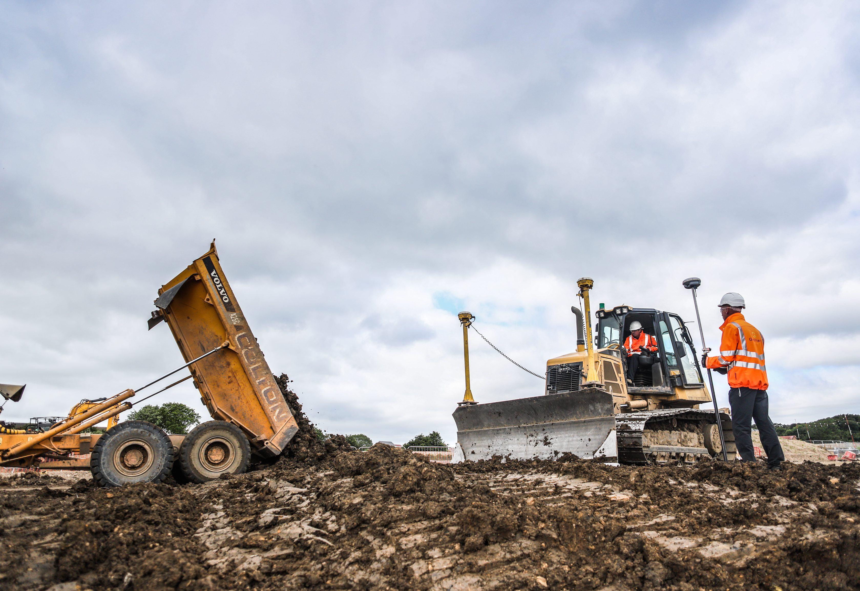 worker maneuvering a bulldozer