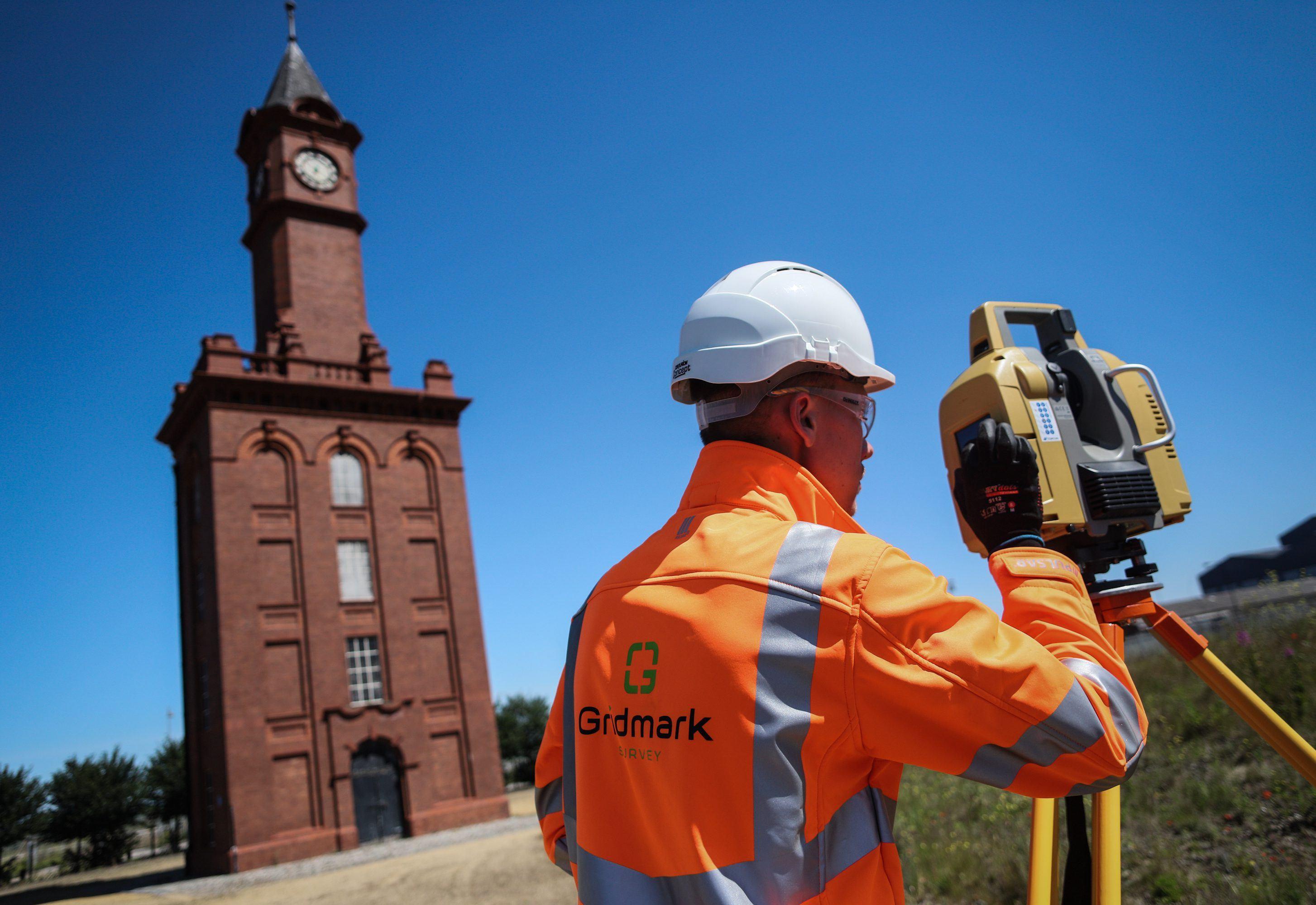 a surveyor surveying a site