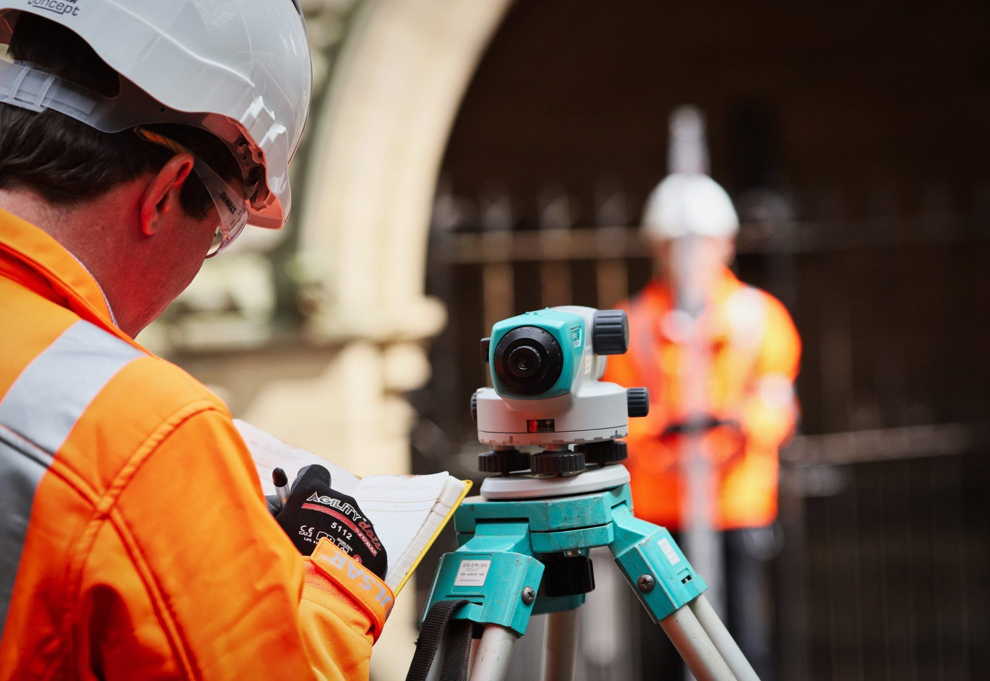 two surveyors surveying a site