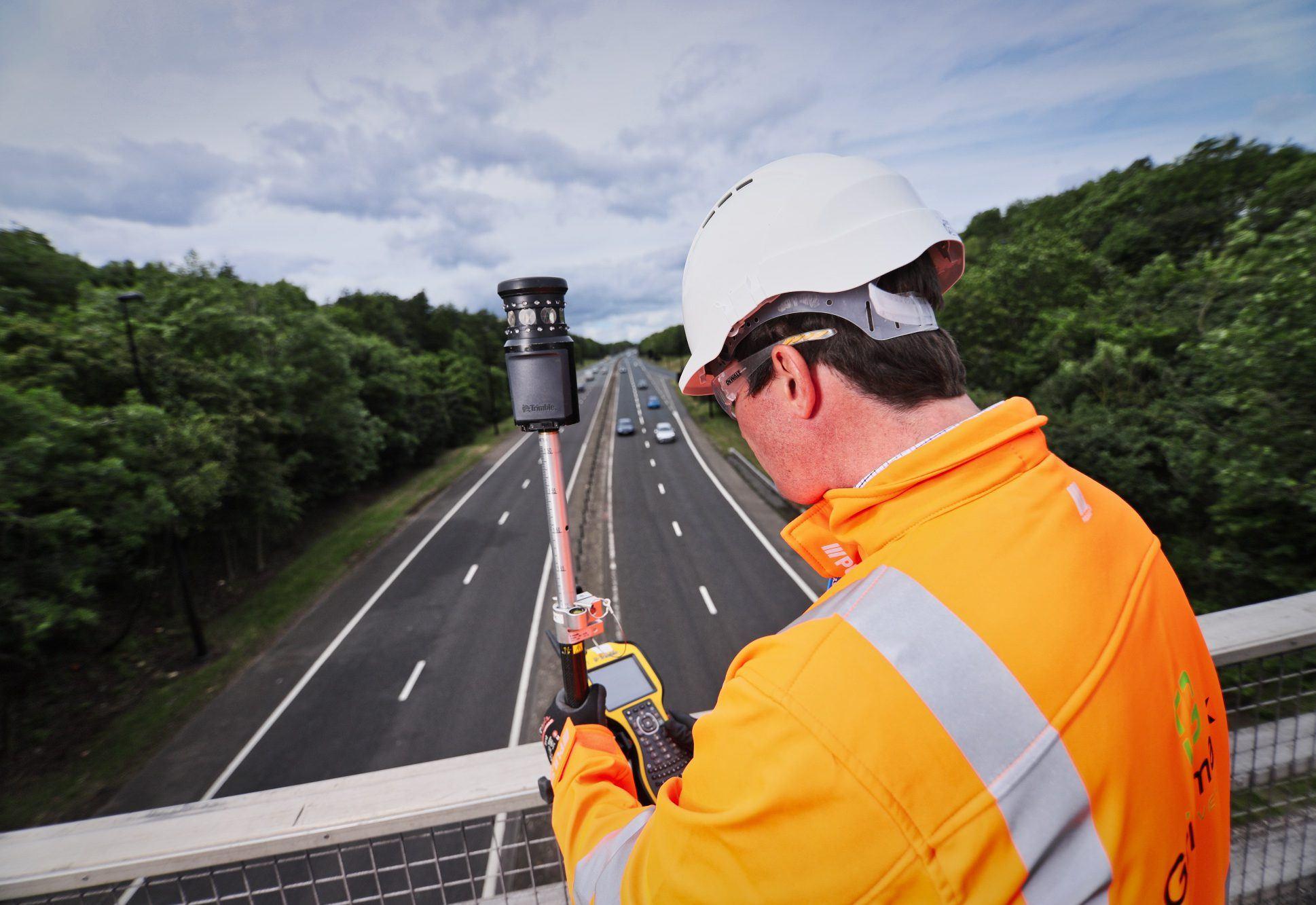 a surveyor surveying a highway