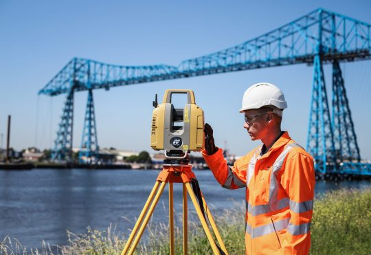 a surveyor surveying a site